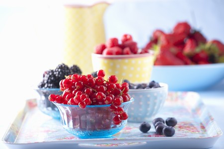Assorted berries in bowls LANG_EVOIMAGES