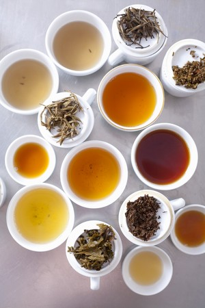 teas: An assortment of brewed teas and tea leaves