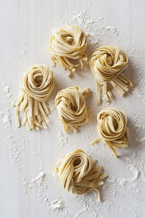 worktops: Nests of flat noodles on a floured worktop (view from above) LANG_EVOIMAGES