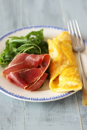 arugola: Omelette with Iberico ham and rocket LANG_EVOIMAGES