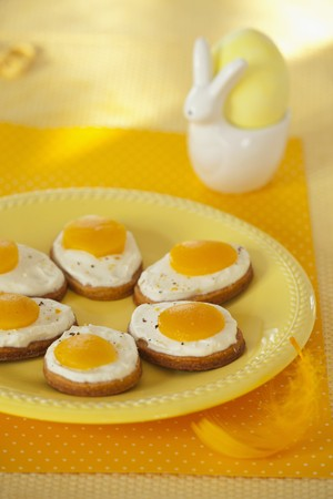 mat like: Easter fried eggs - butter biscuits topped with cream and apricot halves