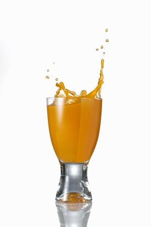 squirted: Juice splashing out of the glass