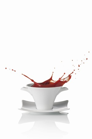 squirted: Tomato soup splashing out of a soup bowl LANG_EVOIMAGES