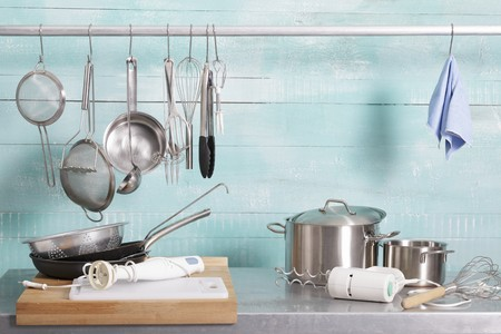liquidiser: Assorted kitchen utensils on a stainless steel unit and hanging on a metal rod LANG_EVOIMAGES