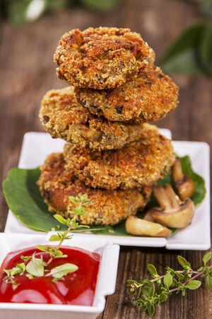 coatings: Mushroom burgers, stacked, with ketchup