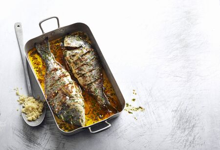 gilthead bream: Gilt-head bream baked in spiced oil