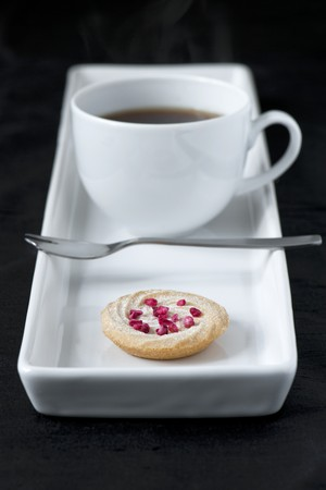 shortbread: Cup of coffee with small shortbread biscuit