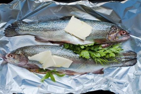 salmo trutta: Fresh two Trout garnished ready to be baked