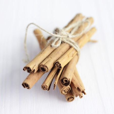 cinammon: A bunch of cinnamon sticks tied with string LANG_EVOIMAGES