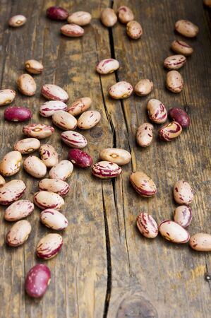 borlotti beans: Dried borlotti beans on a wooden surface
