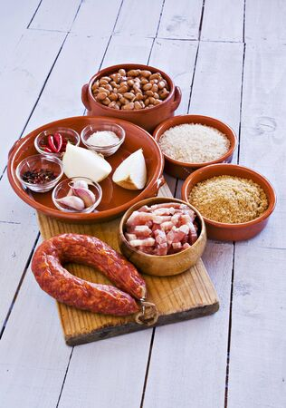 southern european: A mixed still life featuring foods from Spanish cuisine