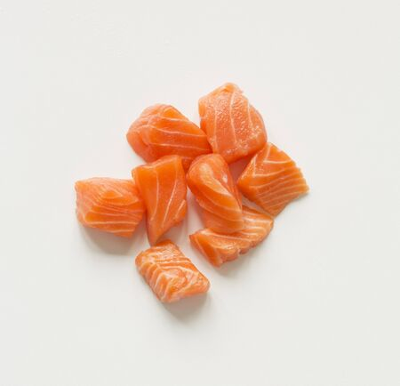 cubed: Cubed Raw Salmon on a White Background