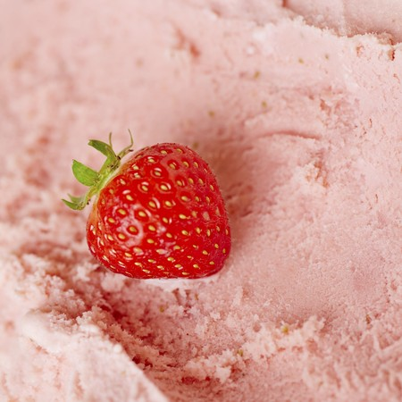 parlours: A fresh strawberry on fresh strawberry ice cream ready to be scooped