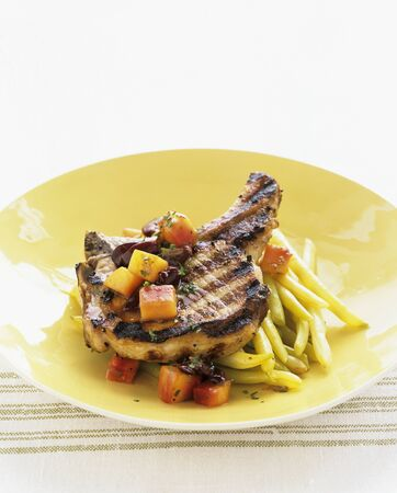 grilled pork chop: Grilled pork chop with yellow beans and carrots