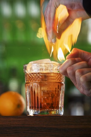 barkeep: A flaming cocktail with orange
