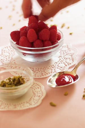 doiley: A spoon of raspberry and rose jam, chopped pistachios and fresh raspberries