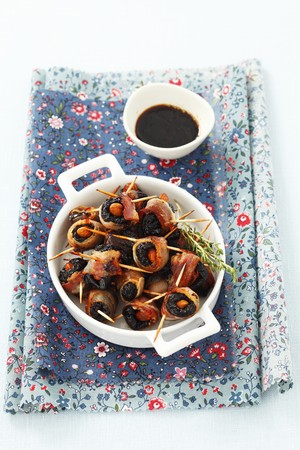 casings: Prunes with almonds wrapped in bacon