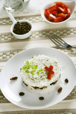 side order: Rice with dried fruit and olives