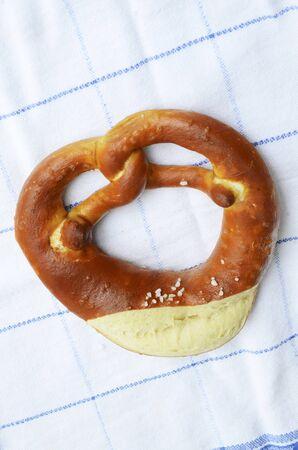 lye: A lye pretzel on a tea towel (seen from above)