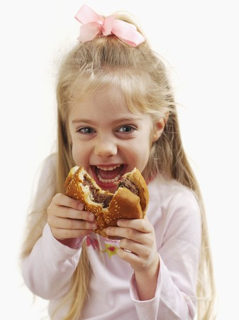 missing bite: A small girl holding a hamburger