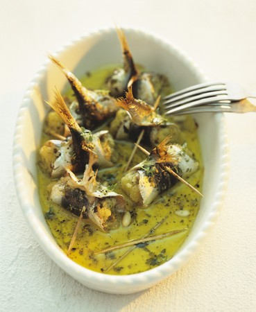 pine kernels: Rollmops with pine nuts in herb oil