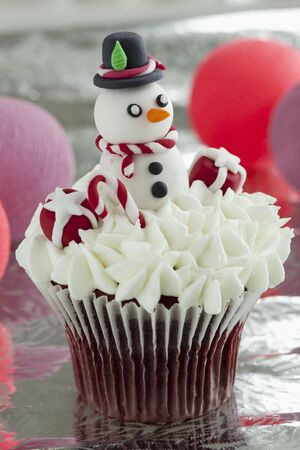 red velvet cupcake: Red Velvet cupcake with cream cheese frosting and a snowman