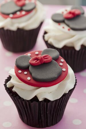 minnie mouse: Chocolate cupcake decorated with Minnie Mouse and buttercream