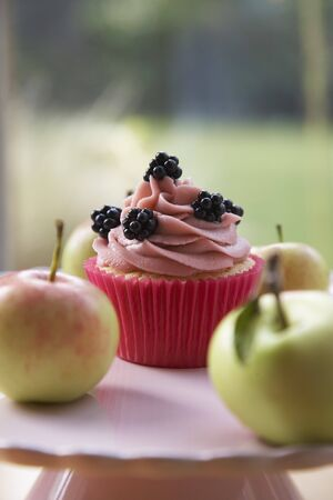 free me: Cupcake with blackberries, surrounded by fresh apples