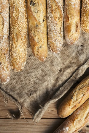 several breads: Several baguettes lying on jute