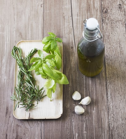 infusing: Basil, rosemary and garlic - ingredients for infusing olive oil LANG_EVOIMAGES