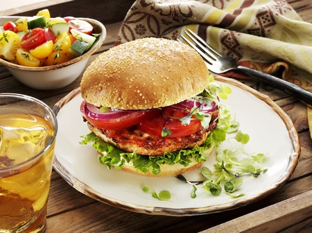 tea breaks: Turkey Burger with Lettuce, Tomato, Red Onion and Micro Greens on a Bun with a Grape Tomato Salad and an Iced Tea on the Side LANG_EVOIMAGES