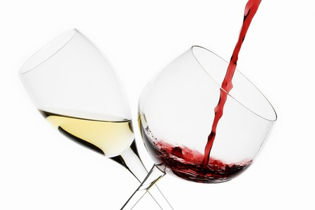 in twos: A Glass of White Wine and a Glass of Red Wine being Poured LANG_EVOIMAGES