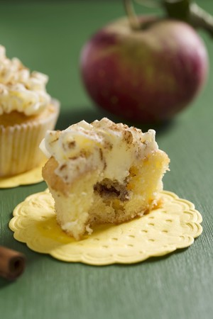 buttercream: A cupcake with apple and cinnamon filling and buttercream icing