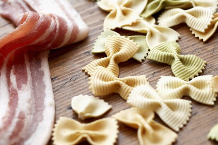 uncooked bacon: Uncooked Bacon and Tri-Color Bowtie Pasta
