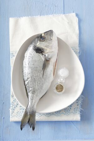 gilthead bream: Fresh gilt-head bream with salt and pepper