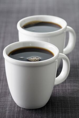 twos: Two cups of black coffee