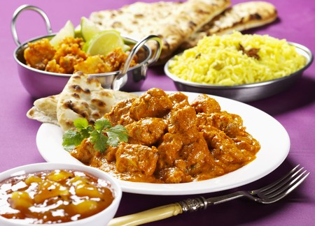 cuisines: Chicken tikka masala with chutney, rice and naan bread (India)