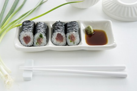 tunafish: Maki sushi with tuna, salmon and cucumber, with soy sauce and wasabi LANG_EVOIMAGES
