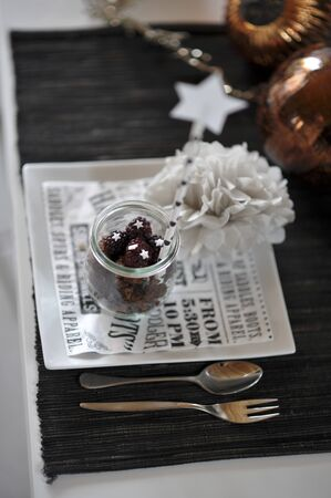 christmassy: A Christmassy place setting with floral decoration and Christmas tree baubles