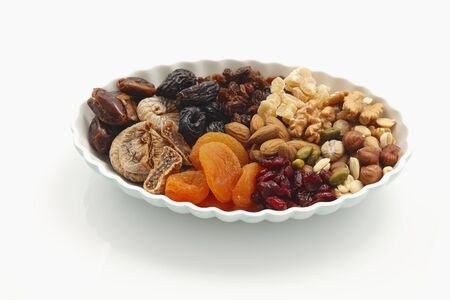pits: Assorted dried fruit and nuts on a plate