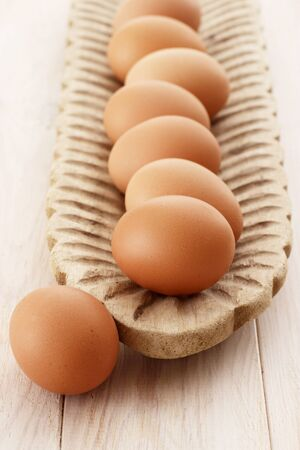 brownish: Brown eggs in a wooden dish