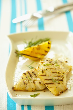 broiling: Grilled halibut fillets with rosemary and lemon