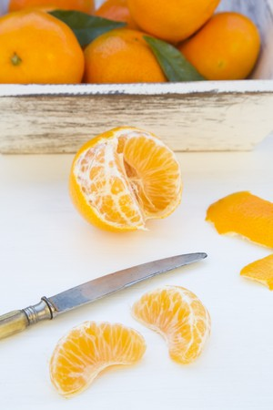 clementines: Clementines, peeled and unpeeled
