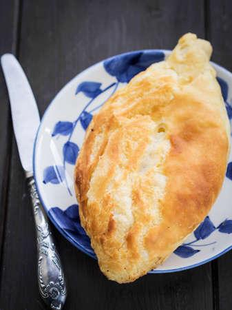 brownness: Traditional Georgian cheese bread (khachapuri) called nahevrad penovani.