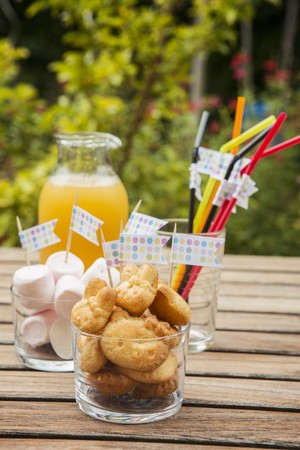 childs birthday party: Baked treats, marshmallows and drinking straws decorated with flags for a childs birthday