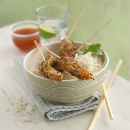 sates: Chicken satay skewers on a bed of rice LANG_EVOIMAGES