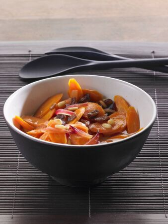 red onions: Carrot salad with pine nuts, red onions and raisins