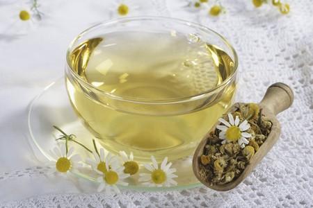 german chamomile: Camomile tea in a glass cup