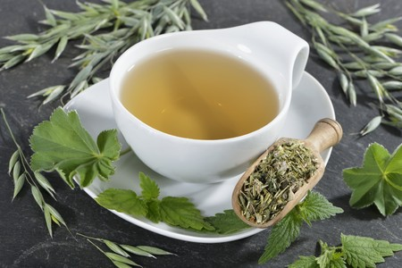 ladys mantle: A cup of herbal tea made from oats, stinging nettle and ladys mantle LANG_EVOIMAGES
