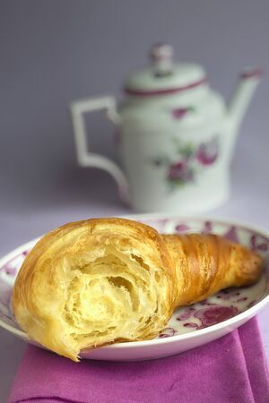 coffeepots: Partly eaten croissant LANG_EVOIMAGES